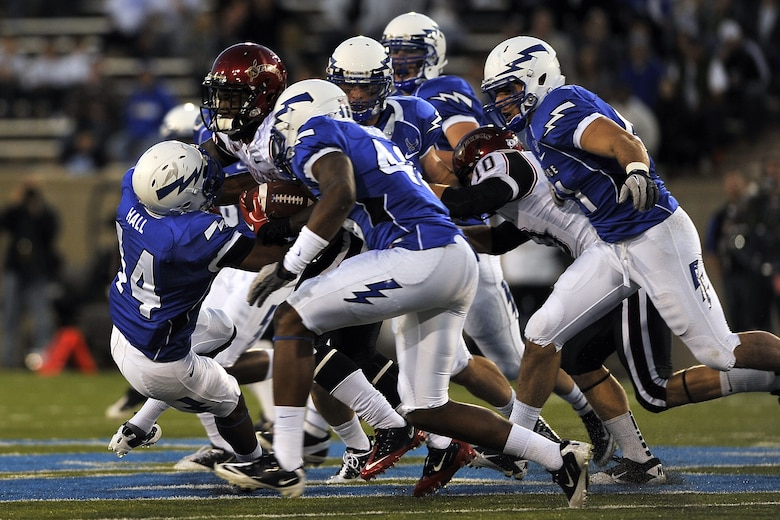 Air Force defensive back Josh Hall leads a tackle during the Falcons' match against San Diego State at Falcon Stadium Oct. 13, 2011. Hall had eight tackles, including five solo tackles, in the Falcons' 41-27 defeat. (U.S. Air Force photo/Bill Evans)