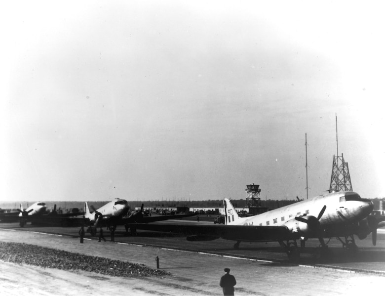 Royal Air Force C-47s being unloaded in the beginning days of flight operations at Tegel. (U.S. Air Force photo)