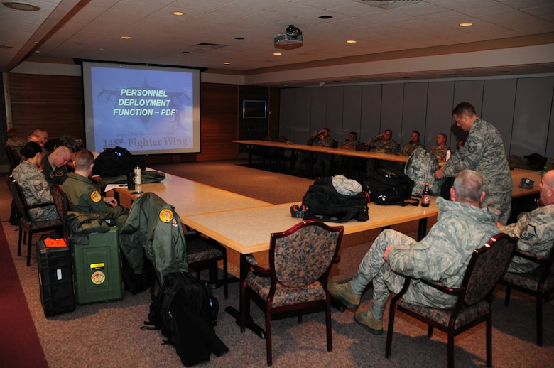 Members of the 148th Fighter Wing meet for a predeployment meeting prior to outprocessing for their impending deployment to Nellis Air Force Base, Nev. for a final two week conversion training mission.  The training during the deployment will be focused on the 148th's new mission--providing suppression of enemy air defense, and the destruction of enemy air defense.  (National Guard photo by Master Sgt. Ralph J. Kapustka.)