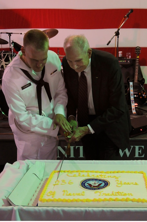 Seaman Andrew Jacobson and retired Navy Captain Bert Howard cut the cake celebrating the Navy's 236th birthday onboard the USS Yorktown at Patriots Point Naval and Maritime Museum, Oct. 14. In keeping with naval custom, the youngest and oldest Sailor at the ceremony receive the honor of cutting the birthday cake with a cutlass. Jacobson joined the Navy in June 2011; Howard joined in 1951 and retired in 1979. (U.S. Navy photo/Petty Officer 3rd Class Brannon Deugan)