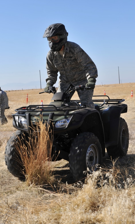 Col. Timothy Cook, 366th Medical Group commander, drives an ATV during a safety training course Oct. 14, 2011, at Mountain Home Air Force Base, Idaho. Cook was one of the six base senior leaders that received the training. (U.S. Air Force photo by Airman 1st Class Heather Hayward)