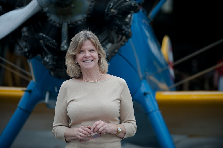 """Jonna Doolittle Hoppes, granddaughter of Gen. James """"Jimmy"""" Doolittle, poses in front of a PT-17 Stearman trainer aircraft at the 2011 reunion of the 63rd Flying Training Detachment in Douglas, Ga., Oct. 18, 2011. General Doolittle was an aviation pioneer, who is best known for the Doolittle Raid in which he led a flight of 16 B-25 Mitchell medium bombers during an attack on Japan April 18, 1942.  (U.S. Air Force photo by Airman 1st Class Jarrod Grammel/Released)"""