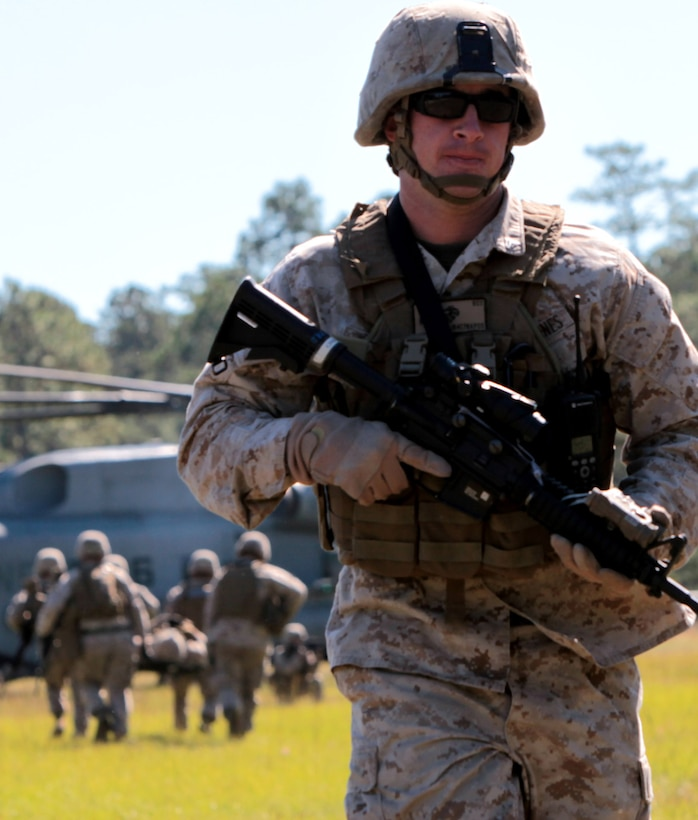 Cpl. Justin Roy, squad leader, 2nd squad, 3rd platoon, Company F, Anti-Terrorism Battalion attached to 2nd Marine Division, walks away from a CH-53E Super Stallion after conducting a casualty evacuation drill aboard Marine Corps Base Camp Lejeune, N.C., Oct. 20. Over the course of the training each platoon performed two casualty evacuation drills in which a junior Marine was responsible for calling in a nine-line medical evacuation request.
