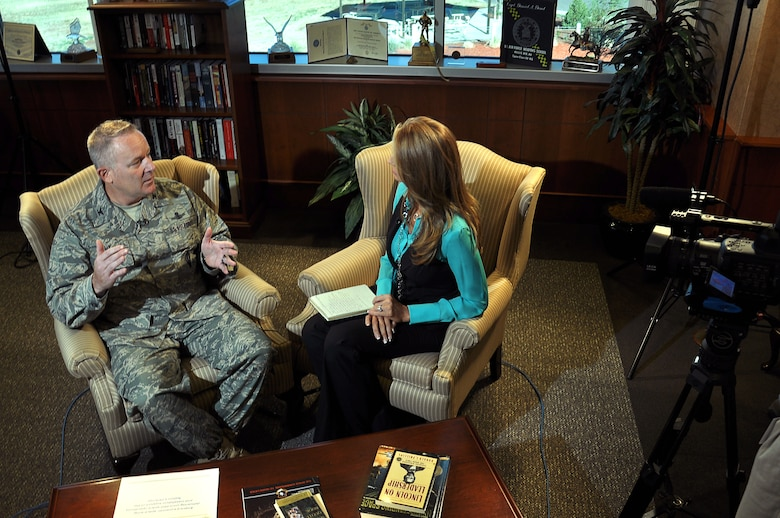 BUCKLEY AIR FORCE BASE, Colo.— U.S. Air Force Col. Daniel Dant, 460th Space Wing commander, talks with Jacquie Palisi, a reporter from Channel 8 in Aurora, Colo. Oct. 14, 2011. Palisi interviewed Dant for a news story that discussed his experiences and how he felt about his position as the Wing Commander. (U.S. Air Force photo by: Master Sgt. Jeromy K. Cross)