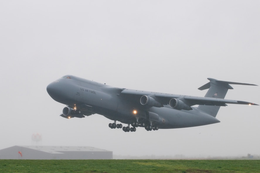 """A C-5 Galaxy aircraft assigned to the 167th Airlift Wing, takes off from Shepherd Field, Martinsburg, WV on October 19, 2011. The aircraft was the seventh aircraft to launch from the unit as part of an Air Force wide """"surge"""" exercise for the C-5 fleet. The exercise, which was testing the United States Transportation Command's ability to rapidly provide strategic airlift in support of contengencies around the world, took place October 17-21 and included 41 C-5 aircraft from the Air Force Active, Reserve, and Guard components. (National Guard photo by Master Sgt. Emily Beightol-Deyerle)"""