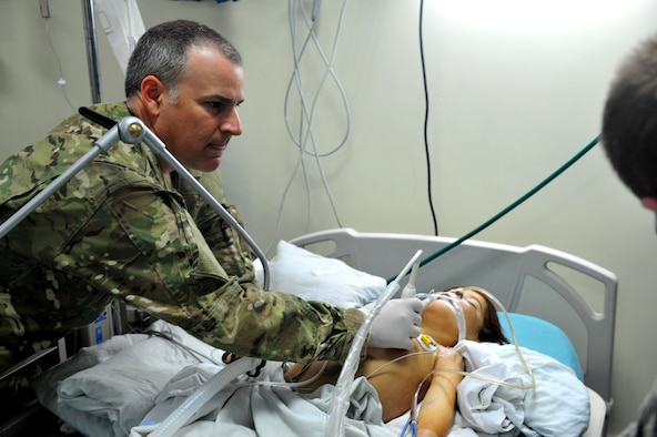 Lt. Col. Derrick Willsey performs an ultrasound on the lung of  Roquia, an Afghan child, Oct. 10, 2011. Willsey is part of the Special Operations Surgical Team, deployed from the 1st Special Operations Support Squadron at Hurlburt Field, Fla.  The SOST team provides medicine to disadvantaged people, provides direct patient care, and builds relationships with local doctors. (U.S. Air Force Photo/SrA Tyler Placie)
