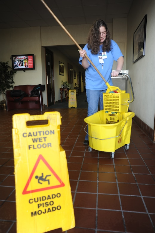 Deborah Melideo, Skils'kin janitorial custodian, mops floors at the Deel Community Center Oct. 13. She has been an employee with Skils'kin for six years. The mission of Skils'kin is to provide support and services to people with disabilities. (U.S. Air Force photo/Airman 1st Class Earlandez Young)