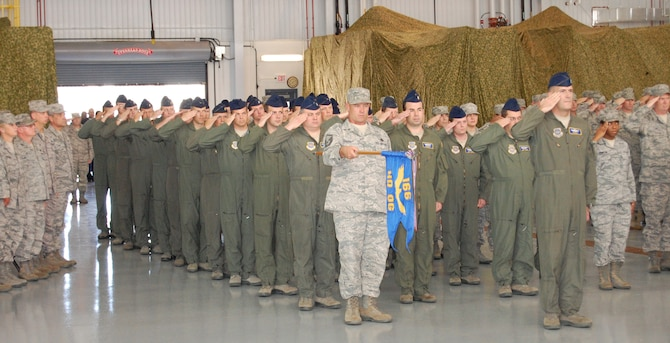 166th Operations Group director of operations Lt. Col. Rob Culcasi, and First Sergeant Master Sgt. Sean O'Neill, holding unit guidon, with over 210 Airmen from the 166th OG, 166th Maintenance Group and 166th Mission Support Group of the Del. ANG, their families and invited guests at a welcome home ceremony Oct. 16, 2011 in the main maintenance hangar at the New Castle ANG Base, Del. The Airmen completed missions lasting three to six months in various locations in Southwest Asia (primarily in Afghanistan), Europe and the U.S., chiefly in support of Operation Enduring Freedom. (U.S. Air Force photo/Tech. Sgt. Benjamin Matwey)