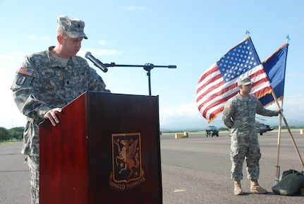 Lt. Col. Michael Breslin, commander of the 1st Battalion, 228th Aviation Regiment,  speaks at a change of command ceremony Oct. 21, 2011, at Soto Cano Air Base, Honduras. Maj. Seth Swartz, company commander, passed the guidon to Capt. Mike Crivello, which symbolized the assumption of command.  (U.S. Air Force photo/Capt. Candice Allen)