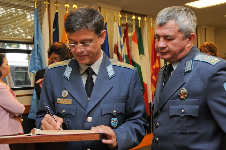 Left, Maj. Gen. Constantin Veselinov Popov, commander of the Bulgarian Air Force and Air War College graduate from 2000, signs a memory book as part of the Honor Roll at the International Officer School Wednesday. Popov was among the 19 selectees inducted this year. The award highlights partnerships between the U.S. and other nations, as well as the accomplishments of the honorees, who have attained the military or civilian rank of chief of staff or higher. (Air Force photo/Chris Baldwin)