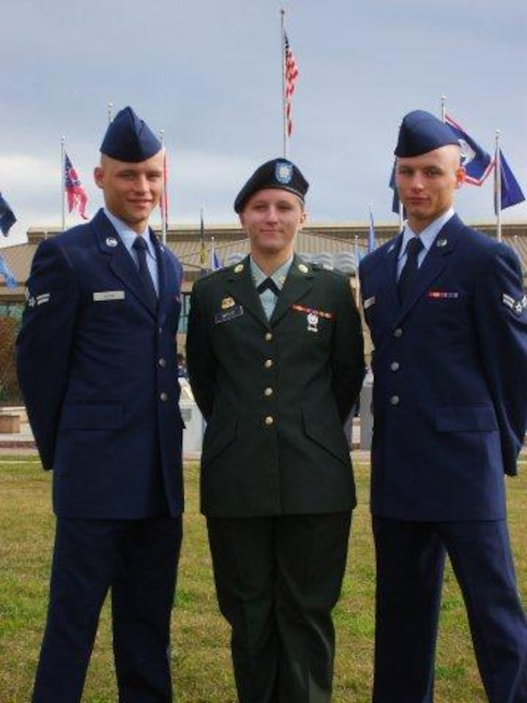Wood brothers, Sean and Chris pose with their older sister Jessica after graduating from Basic Military Training at Lackland AFB, Texas. Courtesy photo provided by the Wood family.