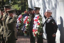 Marine Corps Base Camp Lejeune and Jacksonville city officials lay wreaths at the base of the Beirut Memorial wall in honor of lost troops during the 25th annual Beirut Memorial Observance Ceremony, held at the Beirut Memorial at the Lejeune Memorial Gardens in Jacksonville, N.C., Oct. 23
