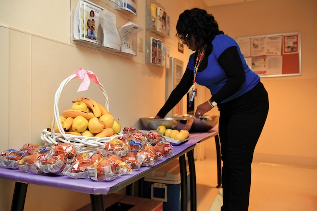 Adrea Jackson, Child Development Center program assistant aboard the Air Station, set up refreshments for the CDC customers who patiently waited as staff worked through the kinks of the Child and Youth Management System Oct. 24.