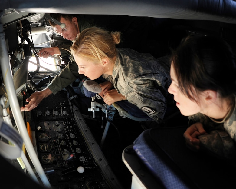 ALTUS AIR FORCE BASE, Okla. – Staff Sgt. Chris Joyce, 54th Air Refueling Squadron boom operator, explains to Spc. Cassandra E. Schoner and Collette Scott from the 4th Battalion 3rd Air Defense Artillery, Fort Sill, Okla., about how the boom on a KC-135 Stratotanker is used to refuel other aircraft, during a tour Oct. 20, 2011. The 4-3 ADA BN brought about 250 soldiers to Altus AFB completing a 10-day training event that tested communications between multiple Patriot missile battery sites and evaluated how the unit would handle scenarios that could be encountered in a deployed environment. (U.S. Air Force photo by Airman 1st Class Kenneth W. Norman / Released / 97th Air Mobility Wing Public Affairs)