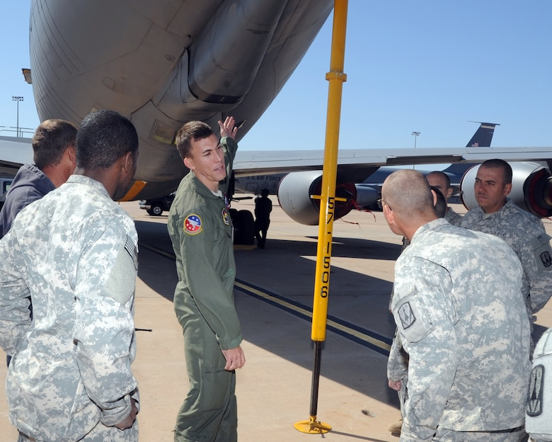 ALTUS AIR FORCE BASE, Okla. – Staff Sgt. Chris Joyce, 54th Air Refueling Squadron boom operator, explains to soldiers from the 4th Battalion 3rd Air Defense Artillery, Fort Sill, Okla., about how the boom on a KC-135 Stratotanker is used to refuel other aircraft, during a tour Oct. 20, 2011. The 4-3 ADA BN brought about 250 soldiers to Altus AFB completing a 10-day training event that tested communications between multiple Patriot missile battery sites and evaluated how the unit would handle scenarios that could be encountered in a deployed environment. (U.S. Air Force photo by Airman 1st Class Kenneth W. Norman / Released / 97th Air Mobility Wing Public Affairs)