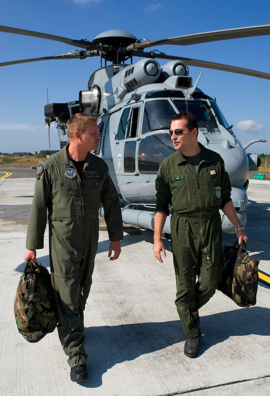 CAZAUX AIR BASE, France --Maj. Scott Adams, 0167th Pyrenees Squadron helicopter pilot, and Capt. Damien Zilka, 0167th Pyrenees helicopter pilot, discuss tactics during exercise Combined Joint Personnel Recovery Standardization Course at Cazaux Air Base, France. One of Major Adam's duties as a member of the 0167th Pyrenees is to coordinate the squadron's participation in international exercises. (Courtesy Photo)