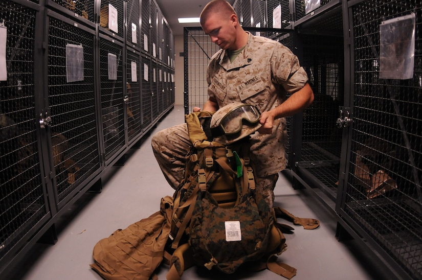 Sergeant James Brantley packs essential gear he will need for an upcoming field exercise. Brantley is a Reservist assigned to the Marine Corps Reserve Training Command, 4th Landing Support Battalion, Charlie Company at Joint Base Charleston - Weapons Station and is preparing for a year-long deployment. (U.S. Navy photo/Petty Officer 1st Class Jennifer Hudson)