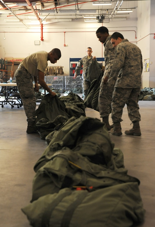 Airmen place Chemical-bags in the correct order at Joint Base Charleston - Air Base, Oct. 20, in preparation for the JB Charleston Operational Readiness Exercise. A C-bag is issued to deploying Airmen if there is a chemical-biological threat in the deployment area and contains two complete ground crew ensembles, M8/M9 paper and decontamination kits. (U.S. Air Force photo/Airmen 1st Class Ashlee Galloway)