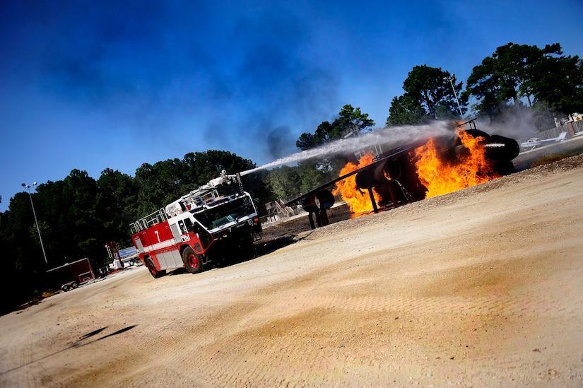 U.S. Air Force firemen begin to extinguish a burning aircraft during a training exercise at Joint Base Charleston - Air Base Oct. 5. ( U.S. Air Force photo/ Senior Airman Jeremy Burns)