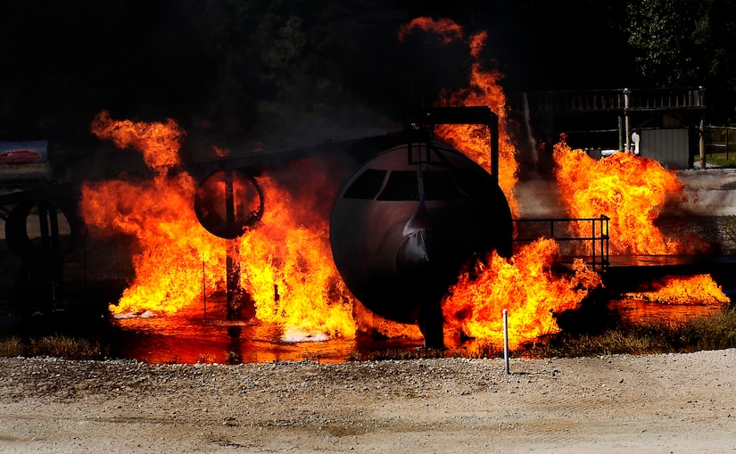 Flames poor out of a training aircraft during a training exercise at Joint Base Charleston - Air Base Oct. 5. The exercise allows Team Charleston fire fighters the ability to practice their fire-response abilities in case of an actual emergency. ( U.S. Air Force photo/Senior Airman Jeremy Burns)