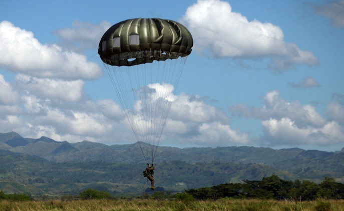 A Marine with Force Reconnaissance Platoon, 31st Marine Expeditionary Unit, prepares to land during bilateral, low level static line parachute training, Oct. 25. The Marine were conducting the training with their Philippine counterparts during the Amphibious Landing Exercise. The 31st MEU is operating in support of the 3rd Marine Expeditionary Brigade for the exercise, is the only continuously forward-deployed MEU and remains the United States' force in readiness in the Asia-Pacific region.