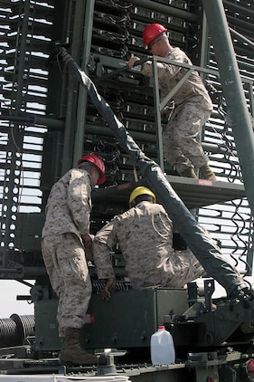 Marines with Marine Air Control Squadron 4 perform maintenance on an AN/TPS-59 long-range surveillance radar while establishing a tactical air operations center on Kadena Air Base Oct. 24. The mission of the TAOC was to support the U.S. Air Force and the U.S. Army during the USAF 18th Wing's quarterly local operational readiness exercise Oct. 26-28. The squadron is a part of Marine Air Control Group 18, 1st Marine Aircraft Wing, III Marine Expeditionary Force.