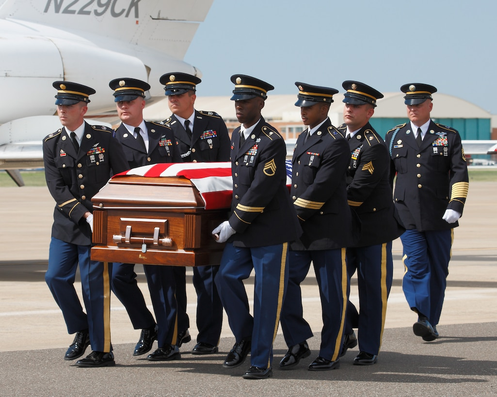 Members of the Army Honor Guard transfers Lt. Damon Leehan to his hearse during a dignified transfer at Will Rogers Air National Guard Base August 23, 2011. (U.S. Army Photo by Sgt First Class Kendall James/Released)