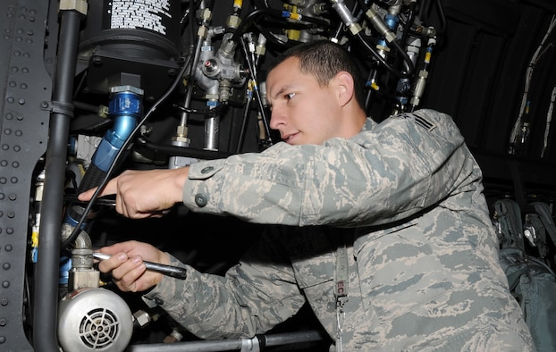 U.S. Air Force Senior Airman David Woliver, 16th Aircraft Maintenance Unit aircraft hydraulics systems journeyman, works on the utility system hydraulic vent line filter aboard the AC-130H Spectre gunship at Cannon Air Force Base, N.M., Oct. 25, 2011. This gives the crew the ability to indicate whether there is a potential danger in the system based on fluid levels within the reservoir. (U.S. Air Force photo by Airman 1st Class Alexxis Pons Abascal)