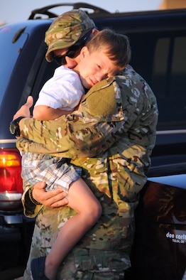 U.S. Air Force Tech Sgt Brandon White, assigned to the 146th Air Support Operations Squadron, says goodbye to his son Gannon before leaving for Afghanistan on Will Rogers Air National Guard base, 11 July, 2011. As a joint terminal attack controller, White will be working alongside the Oklahoma Army Guard providing air support in hostile environments.  (U.S. Air Force Photo by Staff Sgt Caroline Hayworth/Released)