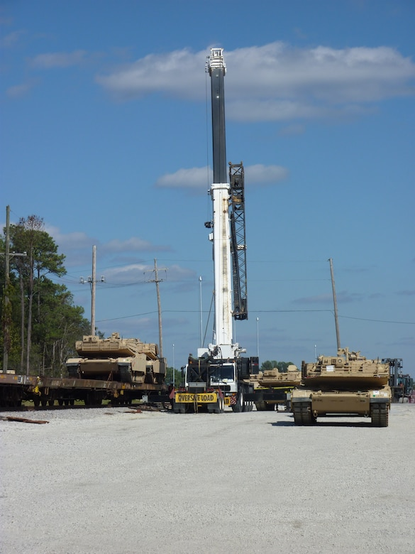 A 70-ton crane gets into position to lift a disabled tank onto a railcar at Joint Base Charleston - Weapons Station Oct. 21. The 841st Transportation Battalion, which is responsible for moving re-deploying cargo that is off-loaded at JB Charleston, loaded 44 track vehicles onto 22 railcars for shipment to multiple locations across the United States.The 841st is a subordinate unit of the Military Surface Deployment and Distribution Command and conducts surface deployment distribution and water terminal operations along the Atlantic Seaboard. (U.S. Army photo/Maj. Scott Hammond)