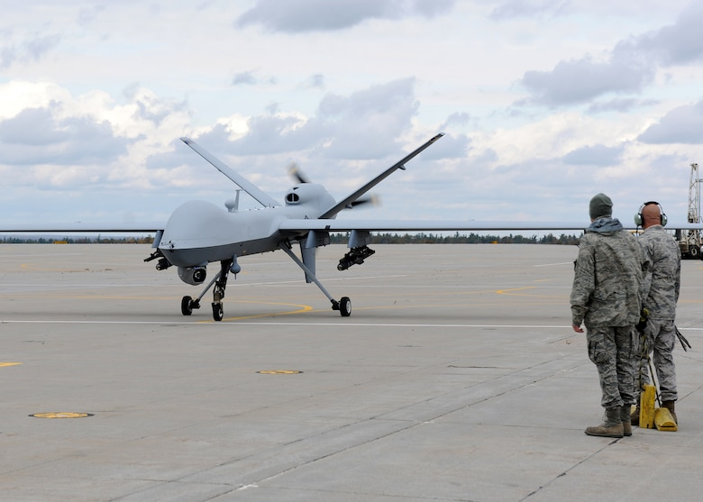 A MQ-9 Reaper from the 174th Fighter Wing, New York Air National Guard, returns from its first flight at Wheeler-Sack Army Airfield, Ft. Drum, NY on 18 October 2011.  The Wing will fly the remotely piloted aircraft in restricted airspace around Ft. Drum to train pilots and sensor operators working from Syracuse's Hancock Field. (US Air Force Photo by Staff Sgt. Ricky Best)