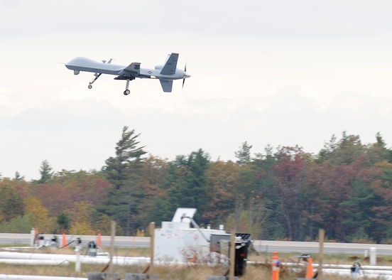 A MQ-9 Reaper assigned to the 174th Fighter Wing, New York Air National Guard, Syracuse takes to the air for the first time on 18 October 2011 at Ft. Drum's Wheeler-Sack Army Airfield. Working out of its launch and recovery site at Wheeler-Sack, the 174th will fly the remotely piloted aircraft in restricted airspace around Ft. Drum. (US Air Force Photo by Staff Sgt. Ricky Best)