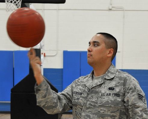 Senior Airman Alfred Peckson, 9th Force Support Squadron, shows off his basketball skills while working at the Harris Fitness Center on Beale Air Force Base, Calif., October 18, 2011. Airman Peckson is a fitness specialist and assists gym members with health and wellness; the 9th FSS is a 2010 Eubank Award winner. (U.S. Air Force photo by Airman 1st Class Rebeccah Anderson)