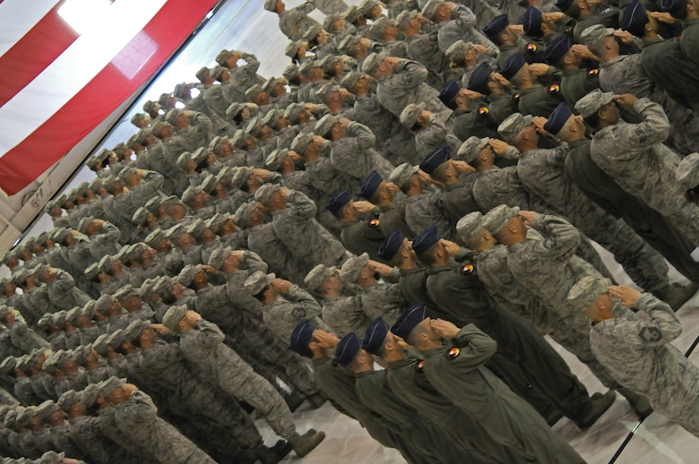 Every available member of the 173rd Fighter Wing stands in formation during the change of command ceremony passing command from Col. James Miller to Col. Jeffrey Silver. (U.S. National Guard photo by Amn. Basic Penny Hamilton) RELEASED