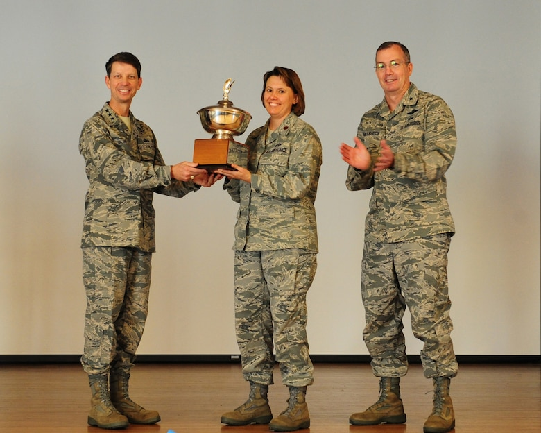 Lieutenant General Darrell D. Jones (left) and Brigadier General Paul H. McGillicuddy (right) present the 2011 Eubank award trophy to Major Connie May, 9th Force Support Squadron commander, during a ceremony Oct. 25, 2011 at Beale Air Force Base, California. The Eubank award recognizes the best installation level force support squadrons evaluating them in mission accomplishment, leadership, innovation, management, customer focus, and customer impact. The award is presented annually to recognize excellence at small bases where there are less than 5,000 Airmen assigned. The award namesake was Maj. Gen. Eugene L. Eubank, a highly decorated pilot who served more than 34 years in the Air Force. General Eubank recognized the importance of morale and welfare for America's fighting forces to further the overall Air Force mission. The Order of Daedalian Foundation established the award in 1990. (U.S. Air Force photo/Mr. John Schwab)
