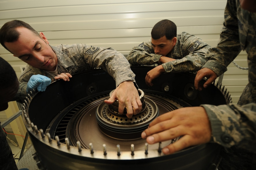 SPANGDAHLEM AIR BASE, Germany -- Tech. Sgt. Steven Bousquet, 372nd Training Squadron propulsion instructor, shows Airmen in his class the different parts of an F-16 Fighting Falcon engine during Aerospace Propulsion Intermediate Maintenance training here Oct. 25. Airmen learn how to build up the core of an engine during the class, which keeps them proficient in their primary duties of maintaining engines. (U.S. Air Force photo/Airman 1st Class Brittney Frees)