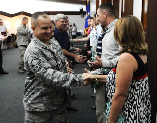 ANDERSEN AIR FORCE BASE, Guam—The 36th Wing quarterly award winners are congratulated during the award recognition breakfast at the Sunrise Conference Center here, Oct. 27. Each group was represented by their quarterly award winning Airmen, NCO, SNCO and civilian during the ceremony. (U.S. Air Force photo by Senior Airman Benjamin Wiseman/Released)