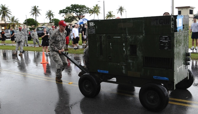 ANDERSEN AIR FORCE BASE, Guam— An Airman from Andersen's 554th Red Horse Squadron pushes a generator during the 36th Contingency Response Group's warrior challenge here, Oct. 21. Each squadron assigned to the 36 CRG competed against each other during the challenge. (U.S. Air Force photo by Senior Airman Benjamin Wiseman/Released)