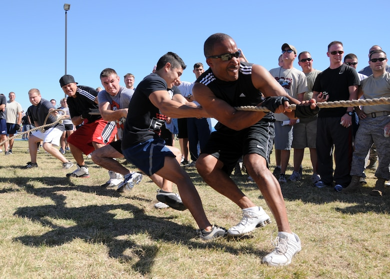 Airmen assigned to the 137th Air Refueling Wing show their strength during a match of tug-of-war held on base, Oct 1. At the end of the day, the 137th ARW came in second place overall.  (U.S. Air Force Photo by Staff Sgt Caroline Hayworth/Released)
