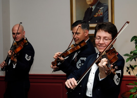 "Members of the Air Force Strings perform selections from its ""Strolling Strings"" repertoire"