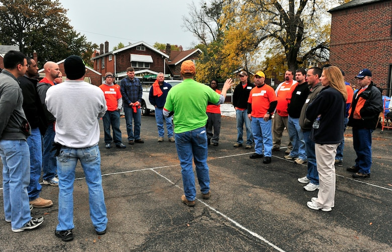 Team Scott and community  volunteers receive instructions from their group leader Oct. 27 during the Celebration of Service campaign event in Saint Louis, Mo. The volunteers rehabilitated a donated church building into a technology training and resource center for veterans allowing them a place to transition from military into civilian life.  The new facility will provide veterans with instruction and skills training to preparing them for employment The campaign launched by Home Depot and the Mission Continues, was created to enhance the lives of U.S. military veterans and to highlight the needs and opportunities they face.  (U.S. Air Force photo/ Staff Sgt. Stephenie Wade)
