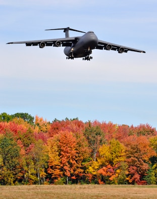 A C-5 Galaxy approaches Westover for landing over fall foliage colors on October 11, 2011. Six of Westover's C-5 transport jets and air crews with Westover's 337th Airlift Squadron participated in an Air Force-wide surge from October 17 to 21. (U.S. Air Force photo/SrA. Kelly Galloway)