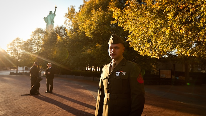"""LIBERTY ISLAND, N.Y.  -- Lance Cpl. Tomas Roginski was one of a few Marines, sailors, airmen, Coast Guardsmen and soldiers to join a group of 125 immigrants in receiving their citizenship on Liberty Island, here, Oct. 28. The event was part of the day-long celebration of the 125th anniversary of the Statue of Liberty's dedication. The Department of Homeland Security rewards immigrants who join the military and serve honorably by exempting them from the normal residency requirements. Secretary of the Interior Ken Salazar told the new citizens, """"You are represent what is best about America, because you represent what Americans should be celebrating and standing for around the world. We are a nation of diversity, and that diversity strengthens our country."""" Roginski immigrated to Brooklyn from Poland when he was a child. He currently serves in the Marine Corps with 6th Communication Battalion and is pursuing a degree in electrical engineering from the College of Staten Island. (Marine Corps production by Sgt. Randall. A. Clinton / RELEASED)"""