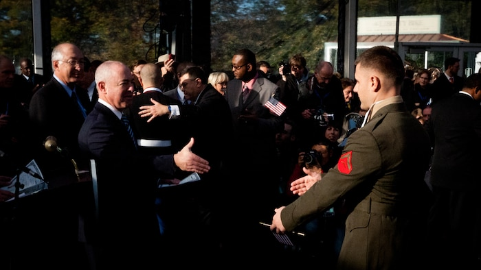 """LIBERTY ISLAND, N.Y.  -- Lance Cpl. Tomas Roginski reaches out to shake the hand of U.S. Citizenship and Immigration Services director Alejandro Mayorkas at the conclusion of his naturalization ceremony, here, Oct. 28. Roginski was one of a few Marines, sailors, airmen, Coast Guardsmen and soldiers to join the naturalization ceremony with the group. The event was part of the day-long celebration of the 125th anniversary of the Statue of Liberty's dedication. The Department of Homeland Security rewards immigrants who join the military and serve honorably by exempting them from the normal residency requirements. Salazar told the new citizens, """"You are represent what is best about America, because you represent what Americans should be celebrating and standing for around the world. We are a nation of diversity, and that diversity strengthens our country."""" Roginski immigrated to Brooklyn from Poland when he was a child. He currently serves in the Marine Corps with 6th Communication Battalion and is pursuing a degree in electrical engineering from the College of Staten Island. (Marine Corps production by Sgt. Randall. A. Clinton / RELEASED)"""