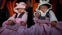 "LIBERTY ISLAND, N.Y.  -- Two babies sleep holding American Flags during a naturalization ceremony for 125 new citizens, here, Oct. 28. Lance Cpl. Tomas Roginski was one of a few Marines, sailors, airmen, Coast Guardsmen and soldiers to join the naturalization ceremony with the group. The event was part of the day-long celebration of the 125th anniversary of the Statue of Liberty's dedication. The Department of Homeland Security rewards immigrants who join the military and serve honorably by exempting them from the normal residency requirements. Salazar told the new citizens, ""You are represent what is best about America, because you represent what Americans should be celebrating and standing for around the world. We are a nation of diversity, and that diversity strengthens our country."" Roginski immigrated to Brooklyn from Poland when he was a child. He currently serves in the Marine Corps with 6th Communication Battalion and is pursuing a degree in electrical engineering from the College of Staten Island. (Marine Corps production by Sgt. Randall. A. Clinton / RELEASED)"
