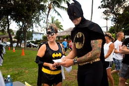 """Alicia and Eric Shoulta, residents of Kailua, prepare to run the 2nd Annual General """"Howlin' Mad"""" Smith 5K here Oct. 29. Many competitors showed up in festive attire to participate in this year's costume contest."""