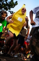 """Cpl. William Baumann, member of the U.S. Marine Corps Forces, Pacific Band, races disguised as a banana in the 2nd Annual General """"Howlin' Mad"""" Smith 5K here Oct. 29. The event attracted service members and Oahu residents to run the scenic route."""
