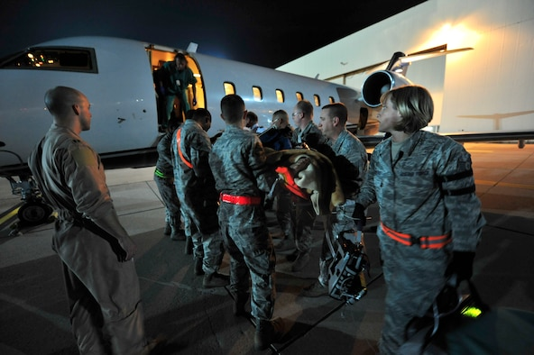 Airmen from the 86th Aeromedical Evacuation Squadron and a Critical Care Air Transport Team from Landstuhl Regional Medical Center, load a wounded Libyan fighter onto a civilian aircraft for transport to a local German hospital, Oct. 29, 2011, Ramstein Air Base, Germany. At the request of the Department of State and directed by the Secretary of Defense, USAFRICOM is supporting U.S. and international humanitarian relief efforts in Libya. Specifically, the U.S. military transported four wounded Libyans for treatment in medical facilities in Europe and 28 to the United States.  (U.S. Air Force Photo by Tech. Sgt. Chenzira Mallory)
