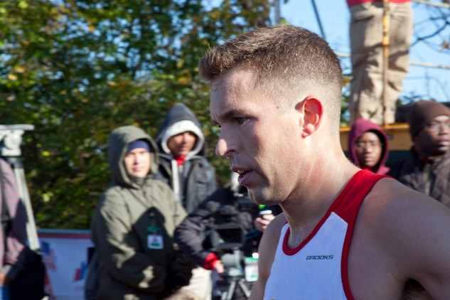 1st Lt. Bill Prom catches his breath after he finished the 36th annual Marine Corps Marathon with a time of 2:29:46. Prom was the first Marine to finish the race held in Washington Oct. 30.