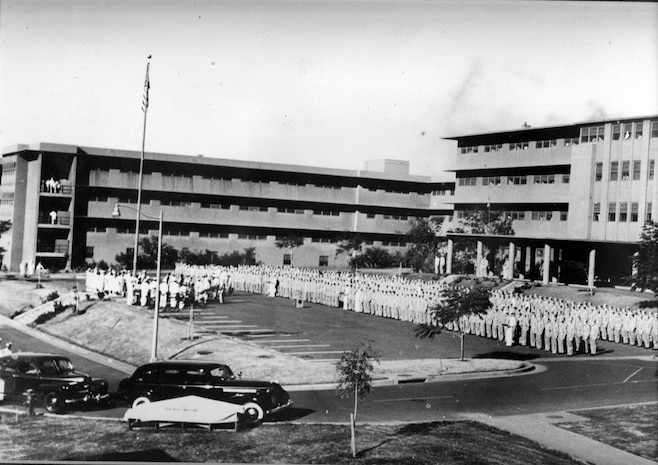 The Aiea Naval Hospital conducts an all-hands formation in front of the hospital here during World War II.  On Jan. 1, 1944, Adm. Chester W. Nimitz ordered all able patients to assemble in front of the hospital in order to personally present the combat-wounded patients their awards. The building that currently headquarters U.S. Marine Corps Forces, Pacific was once the primary rear-area hospital for the Navy and Marine Corps during World War II.